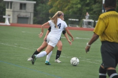 Sophomore midfielder Nicole takes on a defender