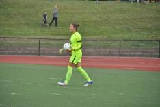 Senior co-captain Emma waits to punt the ball