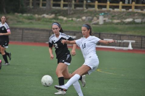 Freshman defender Tori clears the ball